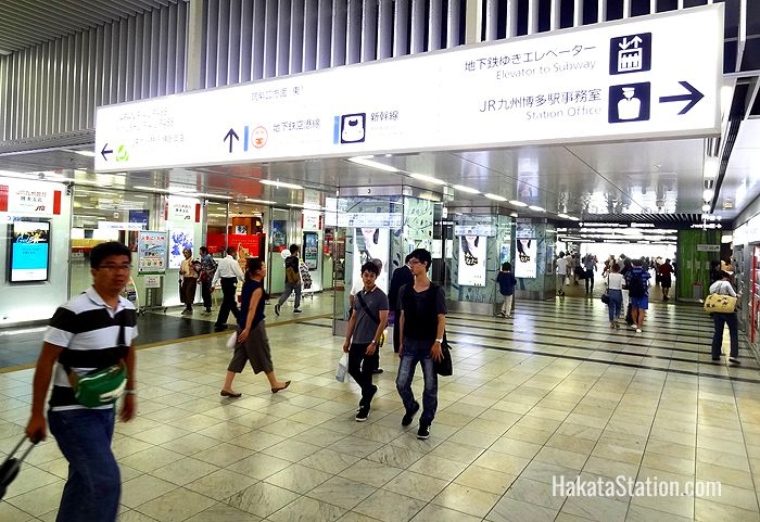 Overhead signs point the way for passengers at Hakata Station
