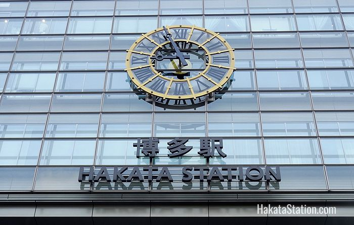 A large clock on the facade of the west or Hakata side of the station