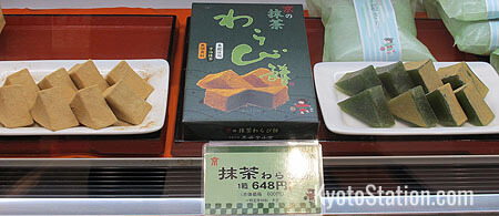 Warabimochi. Those on the right have been flavored with matcha powdered green tea