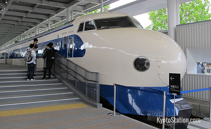 The series 0 shinkansen is on display in the promenade at the entrance to the museum