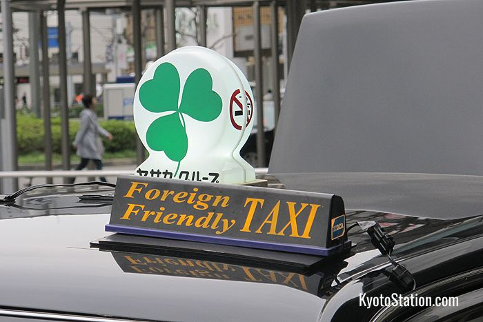 "Taxis with English speaking drivers are labeled with ""foreign friendly"" signs"