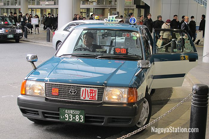 A taxi at Nagoya Station with its automatic door open