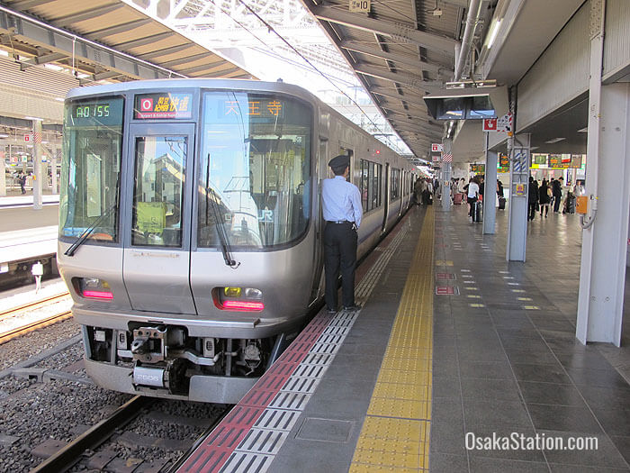 Osaka Loop Line train departing from Osaka Station