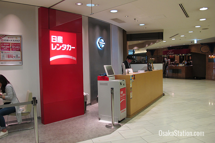 The desk for Nissan Rent-a-Car is south of Osaka Station on the 1st floor of the Umeda Maru Building
