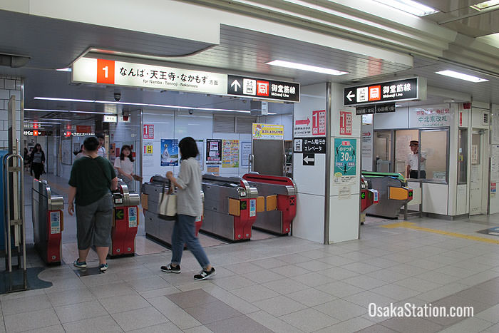 Umeda Subway Station ticket gates are sign-posted for the Midosuji Line