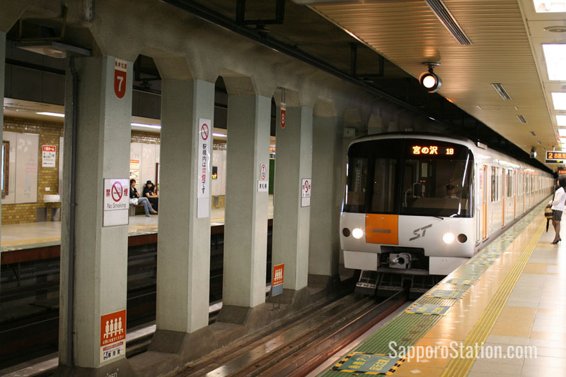 Sapporo subway Tozai line train entering the station.