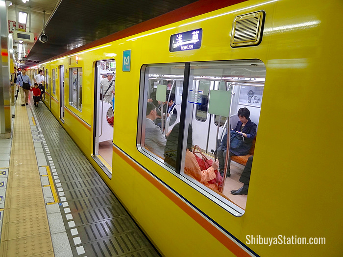 A Ginza Line train waits for passengers to board at Shibuya Station