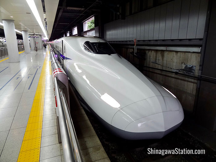 A Tokaido bullet train bound for Shin-Osaka stops at Shinagawa Station