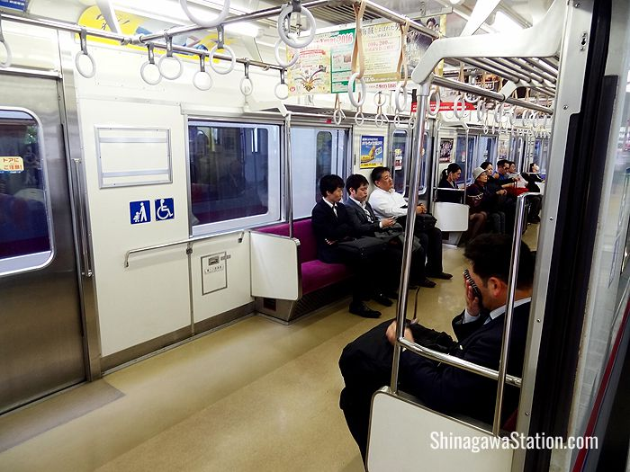 The Keikyu trains have benches and are not as comfortable as the Narita Express