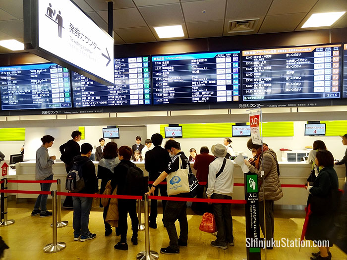 Passengers queue for tickets on the fourth floor of Basuta Shinjuku