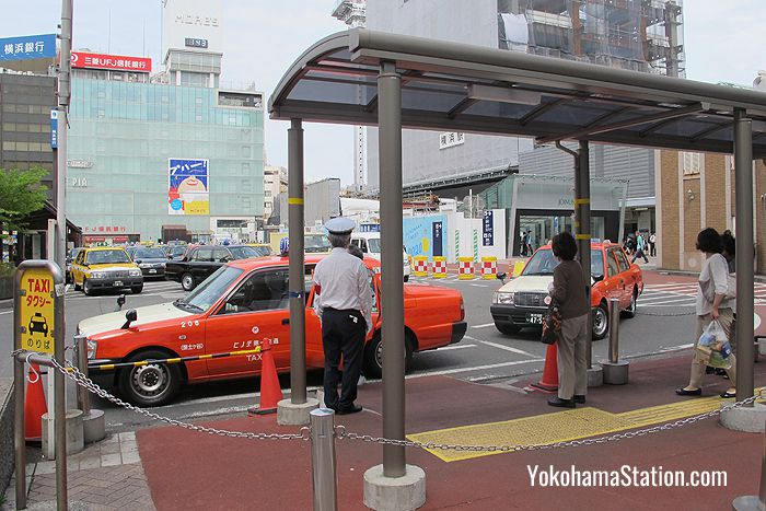 Taxis lining up at the Yokohama Station taxi rank